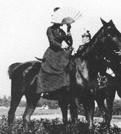 Sissi (Empress Elisabeth of Austria) while hunting with face-covering fan--protection from the prying eyes of the multitudes. A prodigious rider.