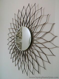A variation on those sunburst mirrors using cereal boxes! Awesome.