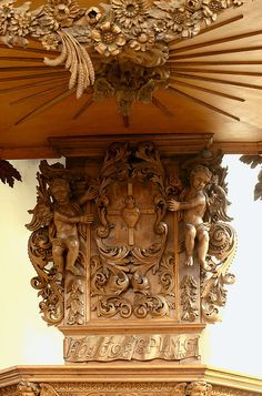"""Kleve, Rheinland, Unterstadtskirche, pulpit, tester, detail  photo by groenling on Flickr    The text reads:  """"Aõ:1698 S·P·L·M·G N·A·fecit"""".    N·A refers to N. Alberts, who made the pulpit in 1698.  I haven't figured out """"S·P·L·M·G"""" yet."""