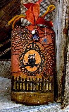Larissa's entry tag for Tim Holtz