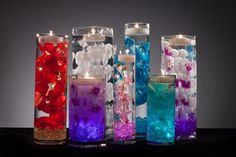 Floral Wedding Centerpieces with LED Lights and Floating Candles.  Simple. Elegant. Beautiful.
