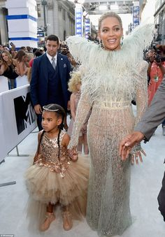 Heavenly Beyonce flutters down red carpet in winged dress with her little angel Blue Ivy at the MTV VMAs