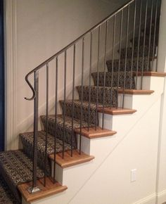 Simple Iron Railing With A Not So Simple Stair Runner.