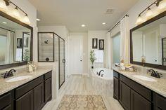 Elyson Model Home Open Daily - 3,791 Sq. Ft. - Master Bathroom - #PerryHomes #trustedbuilder #Elyson #KatyTX #KatyHomes #KatyISD #HoustonHomes #realestate #openconcept #openfloorplan #interiordesign #masterbathroom #masterbath #mastersuite #masterretreat #gardentub #bathroomvanities #vanitylighting