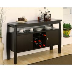 @Overstock - Add an elegant touch to any room with this durable espresso buffet table. The elegant, modern-styled table features clean lines, two doors with nickel knob accents, and center slot compartments that will house standard-size wine bottles.http://www.overstock.com/Home-Garden/Zarina-Dark-Espresso-Buffet-Table/6765447/product.html?CID=214117 $219.59