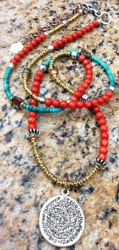 Phaistos Disc Necklace: Long Bohemian Style Red Coral, Turquoise and Silver Medallion Necklace $150 Click to buy
