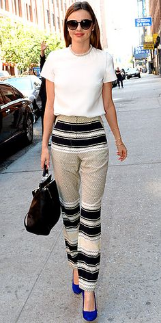 MIRANDA KERR While half the population is focused on getting into the model's pants, the other half is focusing on just getting her pants. They're by Ellery Bobcats and we give her props for pairing them with basics (a white Stella McCartney tee and a Phillip Lim bag), plus one hint of color (electric-blue Manolos).
