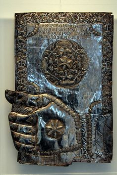 The hand of Christ with holds a bound Gospel. Probably belongs to the silver revetment of the icon. The book cover bears vegetal motifs. Byzantine and Christian Museum, Athens, Greece.