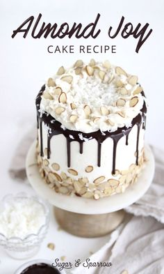 Layers of delicious coconut cake, coconut-almond buttercream, and milk chocolate ganache for the tastiest Almond Joy Cake ever | Sugar & Sparrow | #almondjoycake #almondjoy #cakerecipe #cake #chocolateganache #coconutcake #dripcake #coconutbuttercream #almondbuttercream