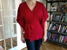 Tops that Flatter: Wrap and faux-wrap tops  Look for:  - Fabric that lies flat across the chest  - A snap closure at the top of the cleavage, or an interior tie  - Wraps that hit below the bust line