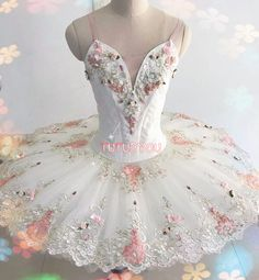 White professional tutus decorated with beads and laces which give it a rich and vivid feeling. Perfect for many classic ballet roles. There might be minor variation in final product due to lace batch changes. Please provide the following measurements: 1. Height (cm) 2..Weight (kg)
