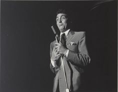 Photograph of Dean Martin performing onstage in the Copa Room, Las Vegas, 1960 Hollywood Glamour, Classic Hollywood, Classic Singers, Great American Songbook, Las Vegas, Joey Bishop, Peter Lawford, Funny Commercials, Funny Ads