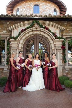 December wedding with bridesmaids in red gowns carrying white and purple boutiques | villasiena.cc