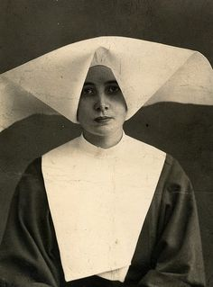 Nun  I wonder why so many orders have such  bizarre head dresses.  So awkward.