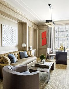 In a Manhattan apartment, artworks in the husband's study include, from left, an Enrico Castellani canvas and two paintings by Donald Judd; the ceiling light is by Serge Mouille. New York City Apartment, Manhattan Apartment, Luxury Office, Apartment Renovation, Modern Sofa, Modern Art, Modern Chairs, Architectural Digest, Home Decor Inspiration