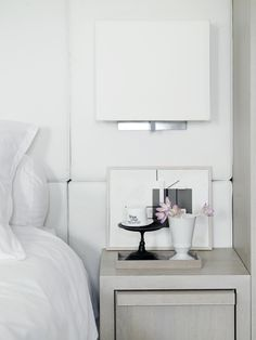 love th e headboard and the bedside, wall-mounted light. the bedside table is pretty nice, as well. It needs to be just as white as the headboard, though. Master Bedroom Interior, Home Bedroom, Modern Bedroom, Bedroom Decor, Modern Interior Design, Interior Styling, Bedroom Styles, Modern Luxury, Beautiful Bedrooms
