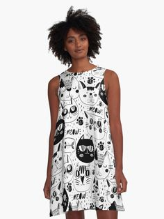 'Faces of White Cats, Black Cats, Cute Cats, Beautiful Cats' A-Line Dress by giftsbyminuet.  A cartoon design featuring cats faces.  We have white cat faces and black  cat faces.  All cats faces are cute and cuddly.  The design includes meow and cat paws.  A lovely artwork for all the cat lovers out there.  #cat #cats #catlover #purr #meow #giftideas #fashion #onlineshopping #artsandcrafts #redbubble #redbubbleartist #art #redbubbleshop #findyourthing @redbubble @giftsbyminuet Day Dresses, Casual Dresses, Summer Dresses, White Cats, Black Cats, People Dress, Cat Pattern, Halloween Outfits, Designer Dresses