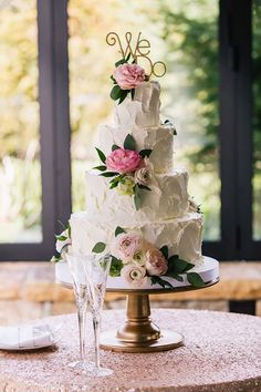 Traditional Spring Wedding in Highlands, North Carolina, Four-Tier White Cake with Fresh Flowers | Brides.com