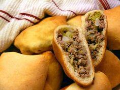 ...Yummy...: German Cabbage Pockets (Kraut Bierok)1 box Pillsbury Hot Roll Mix 1 head of cabbage 1 onion 1lb ground beef Salt&Pepper