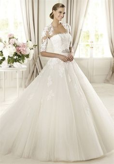 Don't love the jacket. Can they do lace straps instead?  PRONOVIAS  DOMINGO  Silhouette: Princess  Neckline: Strapless  Waist: Empire  Gown Length: Floor  Train Style: Attached  Train Length: Semi-Cathedral  Sleeve Style: Strapless  Fabric: Tulle  Embellishments: Embroidery  Color: Ivory  Size: 4 - 24  Price: $$$
