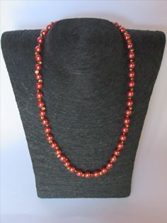Red lustre glass beads with gold colored top drilled nugget sweetwater pearls with a gold colored magnetic clasp