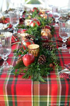 Greenery centerpiece, candles and ornaments.