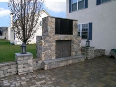 An outdoor ventless gas fireplace with an outdoor tv cabinet is a great addition to this outdoor living space.