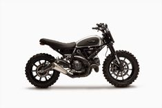 """Cool Ducati Scrambler Dirt Tracker built by Gessato. They made the Scrambler look a bit more aggressive and """"dirty"""". Moto Scrambler, Moto Ducati, Ducati Scrambler Custom, Ducati Custom, Bobber Custom, Custom Bikes, Triumph Motorcycles, Cool Motorcycles, Vintage Motorcycles"""