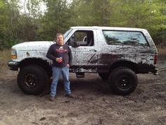 My Hubby and his Toy ! 1996 Ford Bronco   6 inch lift on 35's ! Unlike me he doesn't get it dirty much !