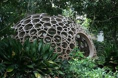 Cardboard rings create a dome pavilion in the garden.  Looks like a cool place to hang out, especially if you are a kid at heart.