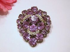 Eisenberg ~ I really love these vintage purple brooches.