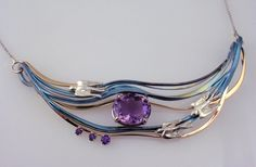 Amethysts, Titanium, 18k Yellow Gold & Sterling Silver for Domestic Abuse Intervention Services