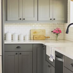@jennasuedesign paired #Silestone countertops with warm grey #cabinets in this…
