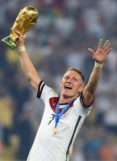 Bastian Schweinsteiger of Germany celebrates with the World Cup trophy after defeating Argentina 1-0 in extra time during the 2014 FIFA World Cup Brazil Final match between Germany and Argentina at Maracana on July 13, 2014 in Rio de Janeiro, Brazil.