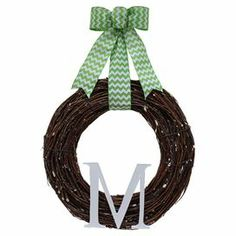 "Adorned with a chevron ribbon and personalized initial, this lifelike wreath is a welcoming accent in the entryway or displayed above your mantel.   Product: Preserved wreathConstruction Material: Silicone, fabric and twigsColor: Multi Features:  Includes preserved twigs  Handmade  Dimensions: 18"" DiameterNote:For indoor use onlyCleaning and Care: Wipe clean with a dry cloth."