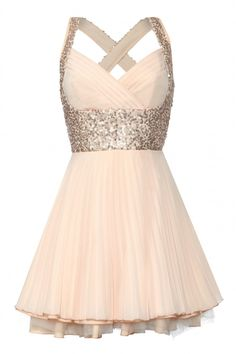 Shimmer in soft peach pleats and sequins in this gorgeous statement dress
