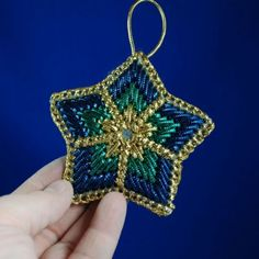 Plastic Canvas Ornaments -- I have seen similar with 3 layers @ http://michelessaleblog.blogspot.ca/2012/11/handmade-items-for-salestar-ornaments.html