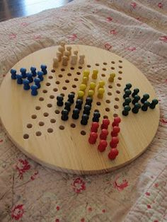 Wooden chinese checkers board game  Carter's favorite game. Maybe a wooden one for Christmas to replace the broken cheap plastic one.