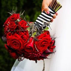 We always love the striking contrast and color pop of a red bouquet! Loving this floral combination and hints of accents used by @flowersbycina, especially the striped ribbon tie. #FlowersByCina #weddingbouquet #bouquet #weddingflowers #weddingflorals #fl