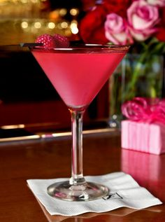 For liquid decadence this Valentine's Day, you can't beat Flemings' Tickled Pink Martini  INGREDIENTS 1 oz. Belvedere Vodka 1 oz. sugar-free raspberry preserve 1 orange wedge squeezed and dropped into shaker  DIRECTIONS Shake on ice. Pour 1.5 oz. of Mionetto Prosecco in martini glass. Pour shaker into martini glass with prosecco. Garnish with 2 fresh raspberries on a bar pick.  only 99 calories - served at Fleming's Prime Steakhouse & Wine Bar Chicago