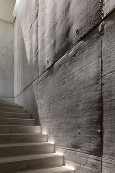 Light bringing to life the beautiful irregular surface of a concrete wall, showing the process of how it was made. Casa da Rainhna by Bruno Erpicum. Photo by Fernando Guerra. Architecture Design, Concrete Architecture, Interior Stairs, Interior And Exterior, Concrete Texture, Concrete Walls, Concrete Staircase, Concrete Interiors, Staircase Design