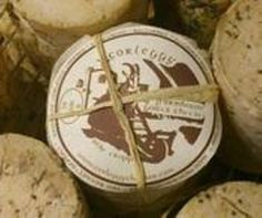 Corleggy - Corleggy is an Irish raw goat's milk cheese, produced by Corleggy Cheeses at the County Cavan, Ireland.     It is a hard handmade cheese with natural rind. The maturation period varies from 8 weeks to 4 months depending on the season, weather.      Corleggy cheese has a distinct nutty and mild flavor. With 40% fat, it is suitable for vegetarians.     It is a rarely found hard goat's milk cheese which is served with Pinot Noir.