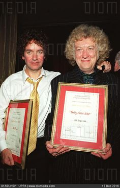 STOCK IMAGE, Left jim lea and right noddy holder british pop singers and songwriters members of the group slade at the british academy of composers and songwriters 27th annual gold badge awards in lon, UGL_018710B_36, 01ASUK5V , UPPA - Search Stock Photos, Images, Pictures, Photography at Diomedia