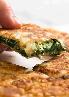 Hand picking up piece of Spinach and Feta Gozleme Spinach Recipes, Beef Recipes, Cooking Recipes, Healthy Recipes, Healthy Food, Recipies, Samosas, Turkish Recipes, Ethnic Recipes