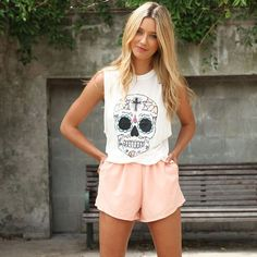 Love the sugar skull shirt. Shorts are unflattering, I think.
