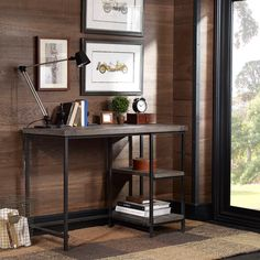 Add style, color, and drama to any room in the house with the Renate writing desk, constructed of the finest material. The solid wood top is hand finished in a warm reclaimed grey, while two working shelves provide for plenty of storage.