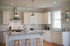 Stainless Steel Range Hood Kitchen Traditional with Floating Shelves Gray Wall