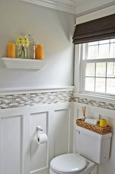 She painted the walls with primer and Benjamin Moore's Wickham Gray, then added board and batten and a tile border. She finished it off with accents of wood, wicker and bright cottage yellow.   - HouseBeautiful.com