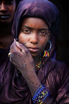 Fulani girl with henna. The Fulani been rocking henna for centuries...