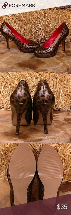 NWOB Leopard Heels Sexy leopard patent stiletto heels with small platform. Never worn. Nine and Company, red interior. Size 6 1/2 4 inch heel 3/4 inch platform. Brown, Tab, Black animal print. Nine & Co Shoes Heels
